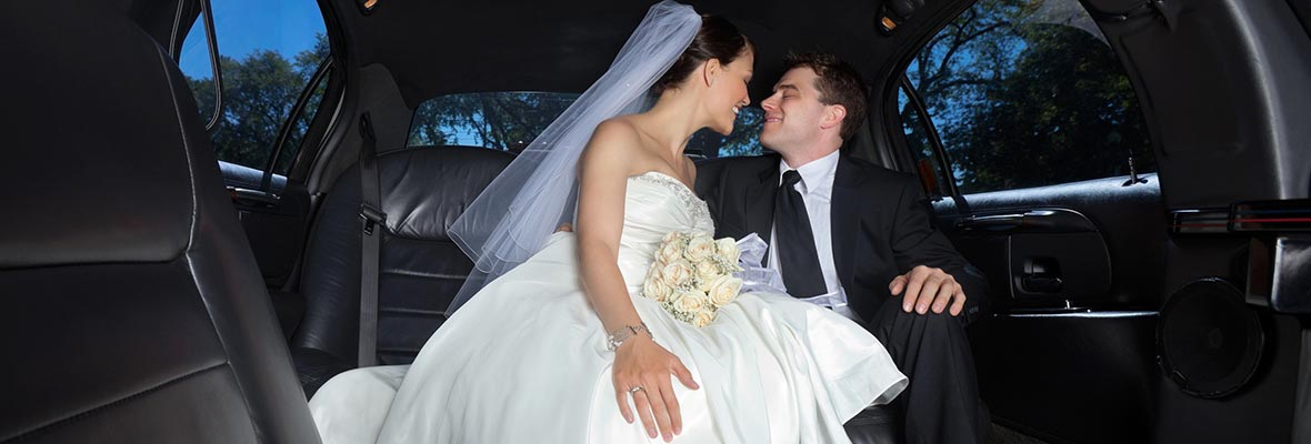 professional chauffeur driving bride and groom after wedding